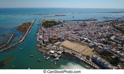Aerial. Fishing village of Fuseta, and views of the Gulf Sea.