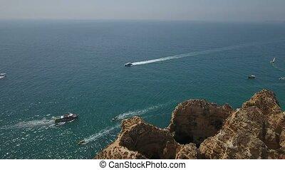 Aerial. Flight and video shooting over the bay with ships Ponta da Piedade.