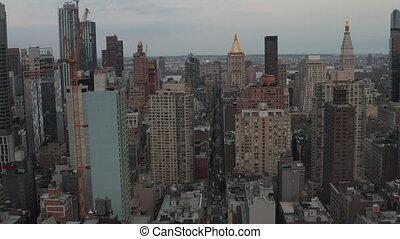 AERIAL: Flight in the heart of Manhattan New York City at Dusk