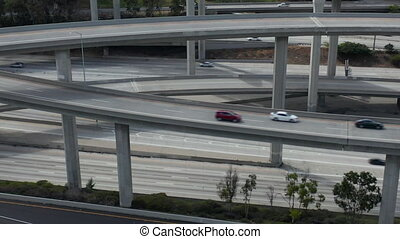 AERIAL: Flight Lowering over Judge Pregerson Huge Highway Connection showing multiple Roads, Bridges, Viaducts with little car traffic in Los Angeles, California on Beautiful Sunny Day HD