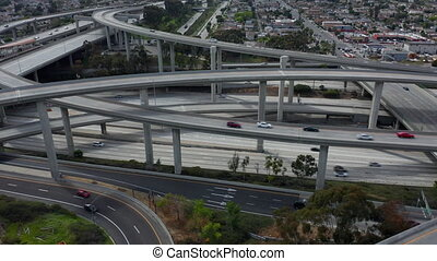AERIAL: Flight Lowering over Judge Pregerson Huge Highway Connection showing multiple Roads, Bridges, Viaducts with little car traffic in Los Angeles, California on Beautiful Sunny Day 4K