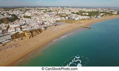 Aerial. Flight of the drone over beach of Albufeira.