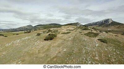 Aerial, flight over a plain field, Sierra De Las Nieves,...