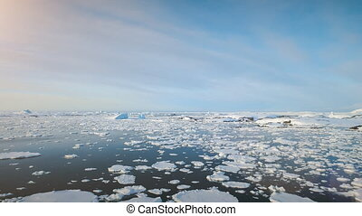 Aerial flight over Antarctica ice ocean water.