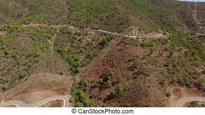 Aerial. Flight Over Curvy Road in Mountains - Aerial. Flight...