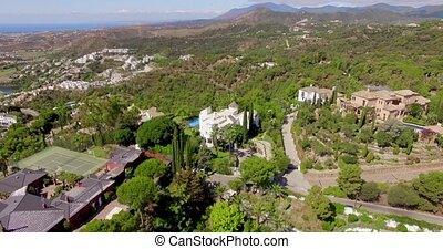 Aerial. Flight Over Houses and Trees in Andalucia