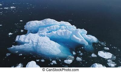 Aerial flight over iceberg in Antarctica ocean. - Aerial...