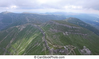 Aerial flight over mountain trails
