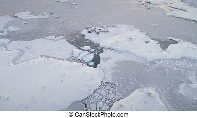 Aerial flight over polar ocean, base. Antarctica.
