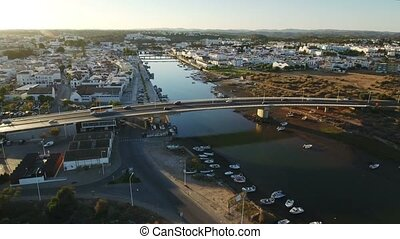 Aerial. Flight over the river Gilao, bridge in Tavira.