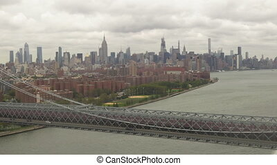 AERIAL: Flight over Williamsburg Bridge towards Empire State Building at cloudy day HD
