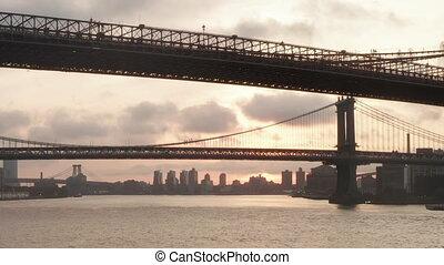 AERIAL: Flight under Brooklyn Bridge at Sunrise in New York City