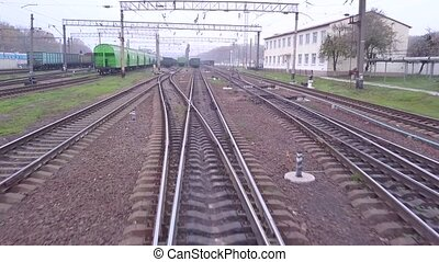 Aerial fly from train tracks on railway