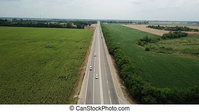 Aerial fly over motorway, freeway traffic - trucks and cars...