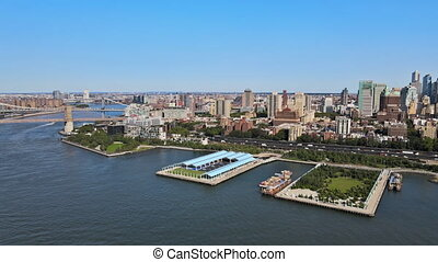 Aerial fly over of Brooklyn rooftops with beautiful Brooklyn apartments at spectacular buildings in New York City