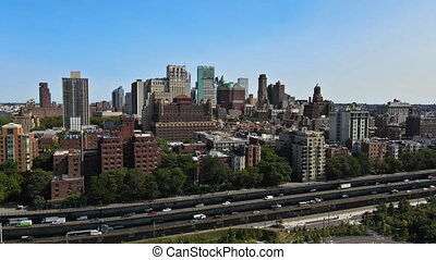 Aerial fly over of Brooklyn rooftops with beautiful Brooklyn apartments