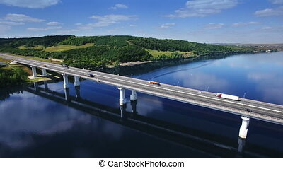 AERIAL Fly over traffic bridge highway roadway road way and...