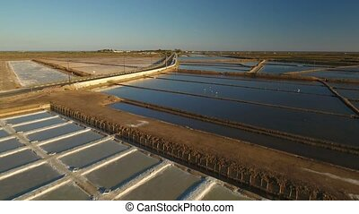 Aerial. Flying a drone over the Ria Formosa saline lakes....