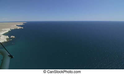 Aerial: Flying above the coast - Flying above the coast of...