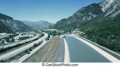 Aerial, Flying along Autoroute De La Maurienne, France -...