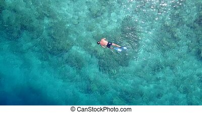 Aerial flying drone view of Maldives white sandy beach young...