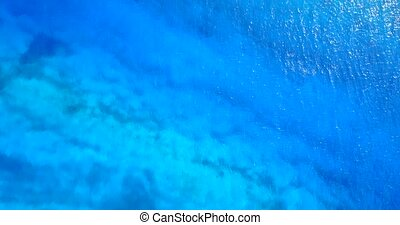 Aerial flying drone view of Maldives white sandy beach abstract waves water surface texture on sunny tropical paradise island with aqua blue sky sea ocean 4k