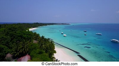 Aerial flying drone view of Maldives white sandy beach on...