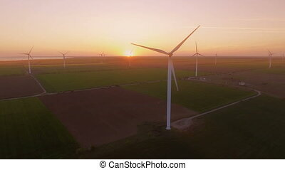 Aerial Flying Over Renewable Energy Wind Farm Wind Turbines....