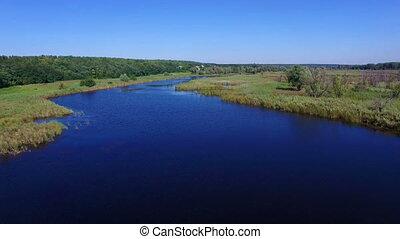 Aerial: flying over river