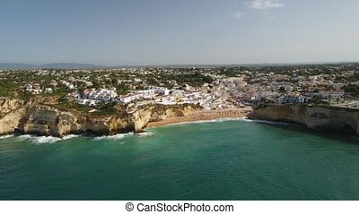 Aerial. Flying over the summer beach town of Carvoeiro. Portugal.