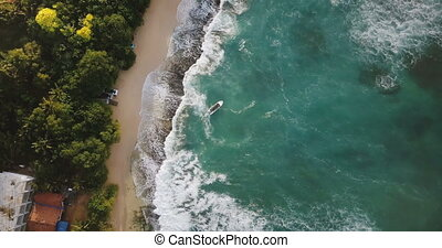 Aerial flyover drone shot of idyllic exotic sea shore with...