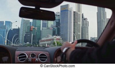 Business district view of Singapore from the car window