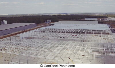 Aerial footage of building new large industrial complex -...