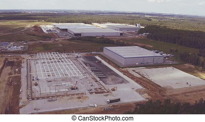 Aerial footage of building new large warehouse