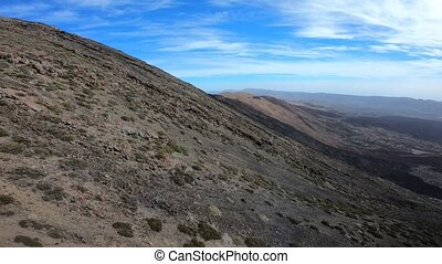 Aerial footage of descending along volcano cone. Teide...