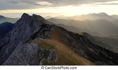 Aerial footage of following spectacular mountain ridge ...
