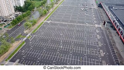 Aerial drone view footage of giant empty parking lot nearly large mall. New quarantine reality