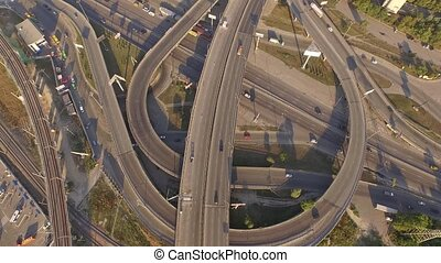 Aerial footage of highway and overpass with cars and trucks.