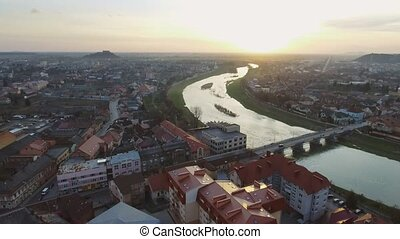Aerial footage of Mukachevo city center - top view at sunset...