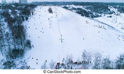 Aerial footage of place for skiing near forest - People...