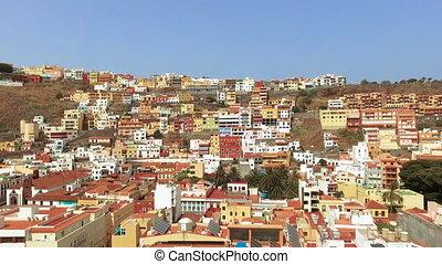 Aerial footage of San Sebastian de la Gomera cityscape,...