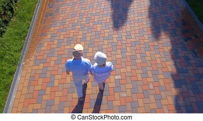 Aerial footage of senior couple walking outdoors