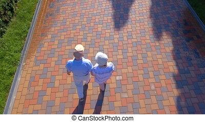 Aerial footage of senior couple walking outdoors - Aerial...