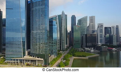 Aerial footage of Singapore skyscrapers with City Skyline -...