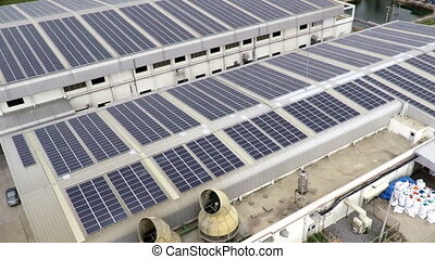 Aerial footage of solar panels on rooftop