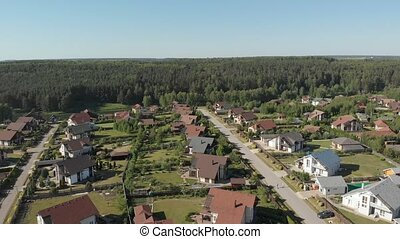 Aerial footage over a classica European housing estate,...