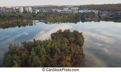 Aerial footage over Echo Park Lake. City park in autumn day...