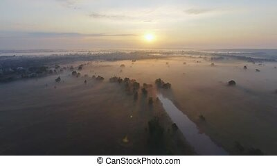 Aerial footage video of foggy morning. Flying over the Desna...