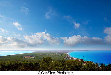 Aerial formentera view with north and south beach unde blue...