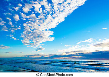 Aerial from a beautiful cloudscape at the atlantic ocean